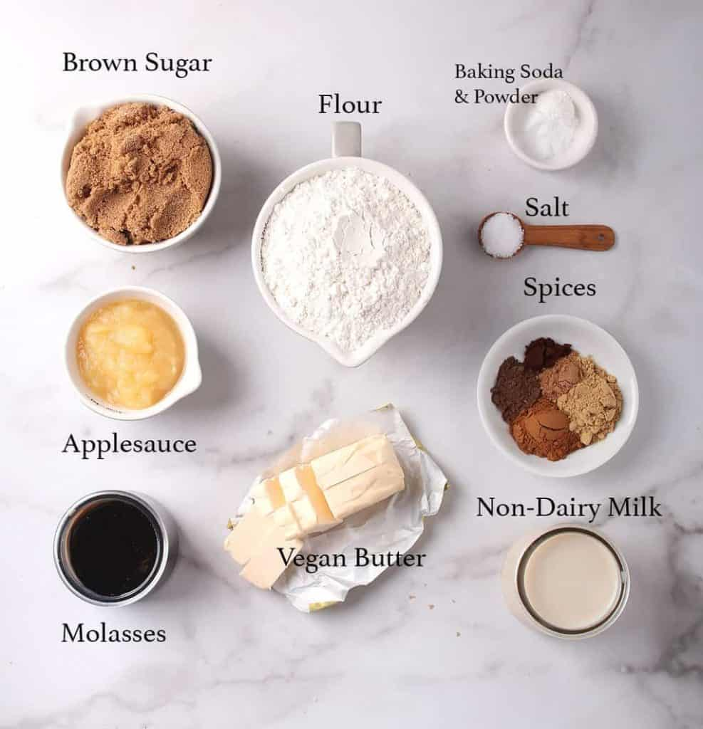 Ingredients for vegan bundt cake on a marble countertop
