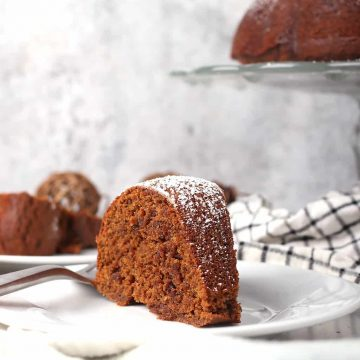 Slice of finished gingerbread cake on a white plate