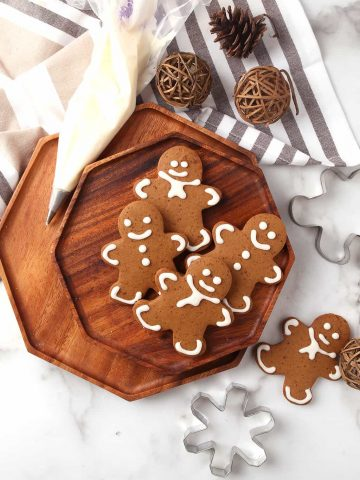 Finished gingerbread cookies on a wooden platter