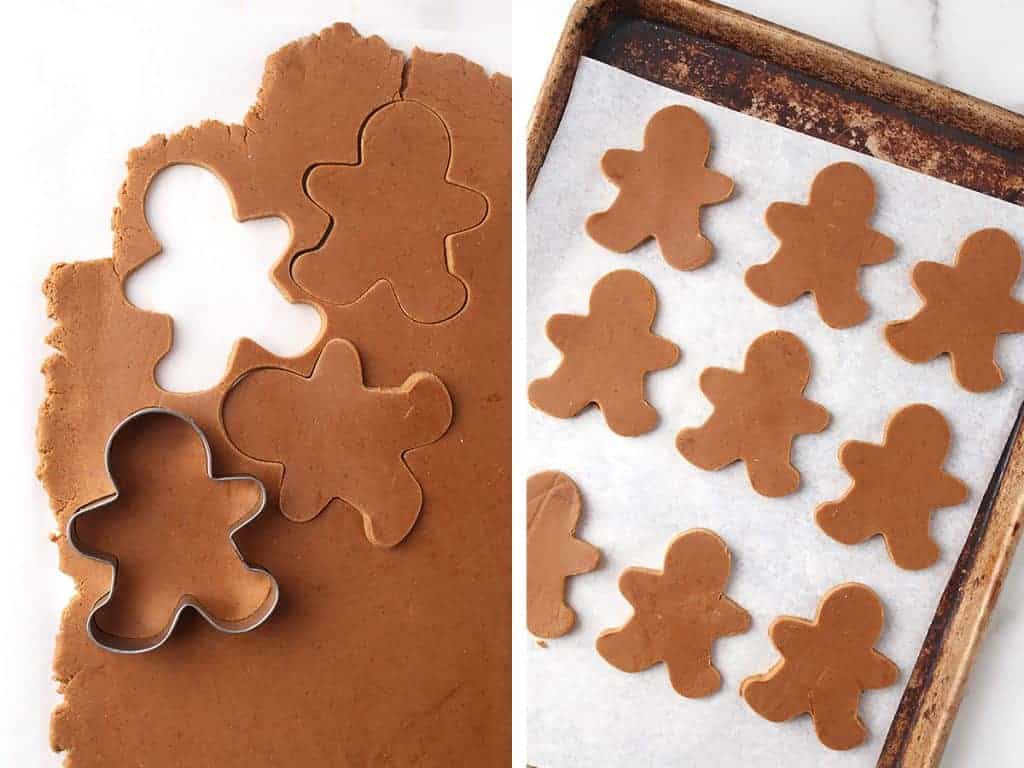 Gingerbread men cut out and placed on a parchment lined baking sheet