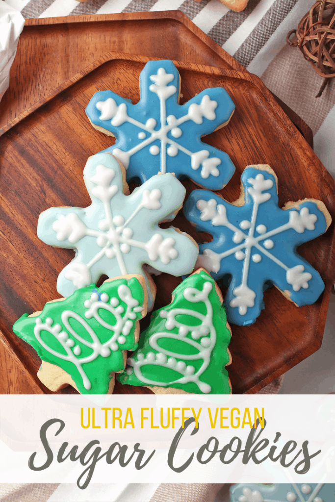 You're going to love these vegan sugar cookies! They are soft, buttery, fluffy, and topped with the perfect royal frosting. This easy cookie recipe makes a delicious holiday treat that you can enjoy year 'round!