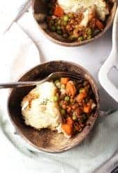 Two servings of shepherd's pie served in two bowls.