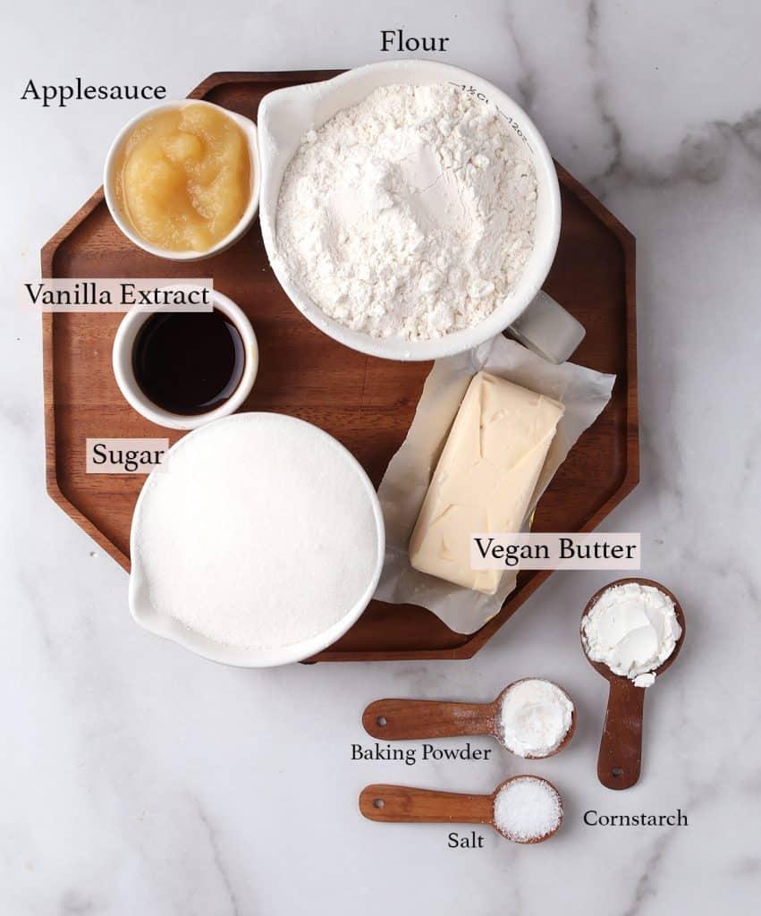 Ingredients for vegan sugar cookies measured into measuring cups