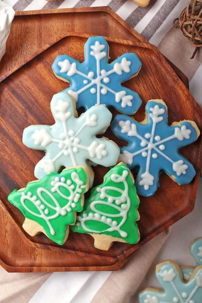 Vegan sugar cookies in shape of Christmas trees and snowflakes
