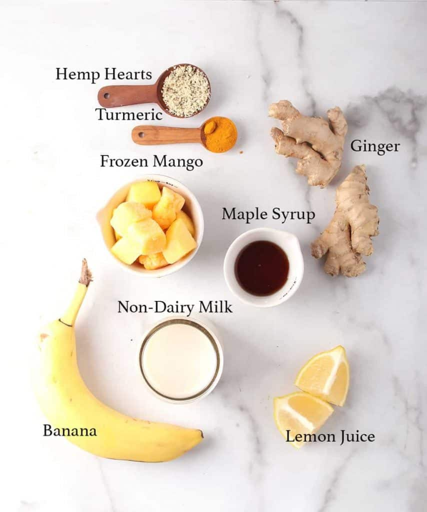 Ingredients for mango smoothie on a marble board