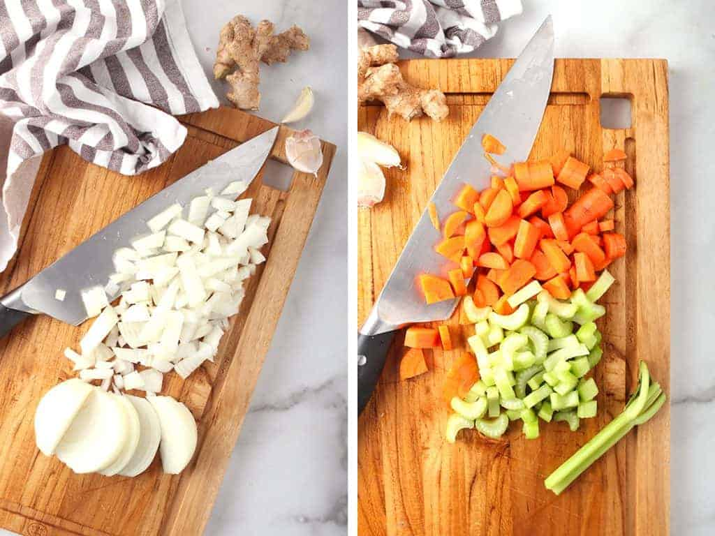 Chopped onions, carrots, and celery on a cutting board