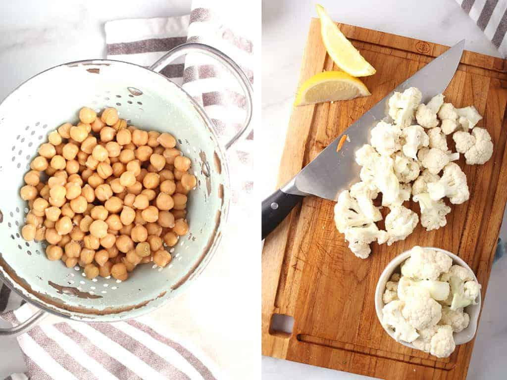 Chickpeas in a colander and bite-sized cauliflower florets on a cutting board