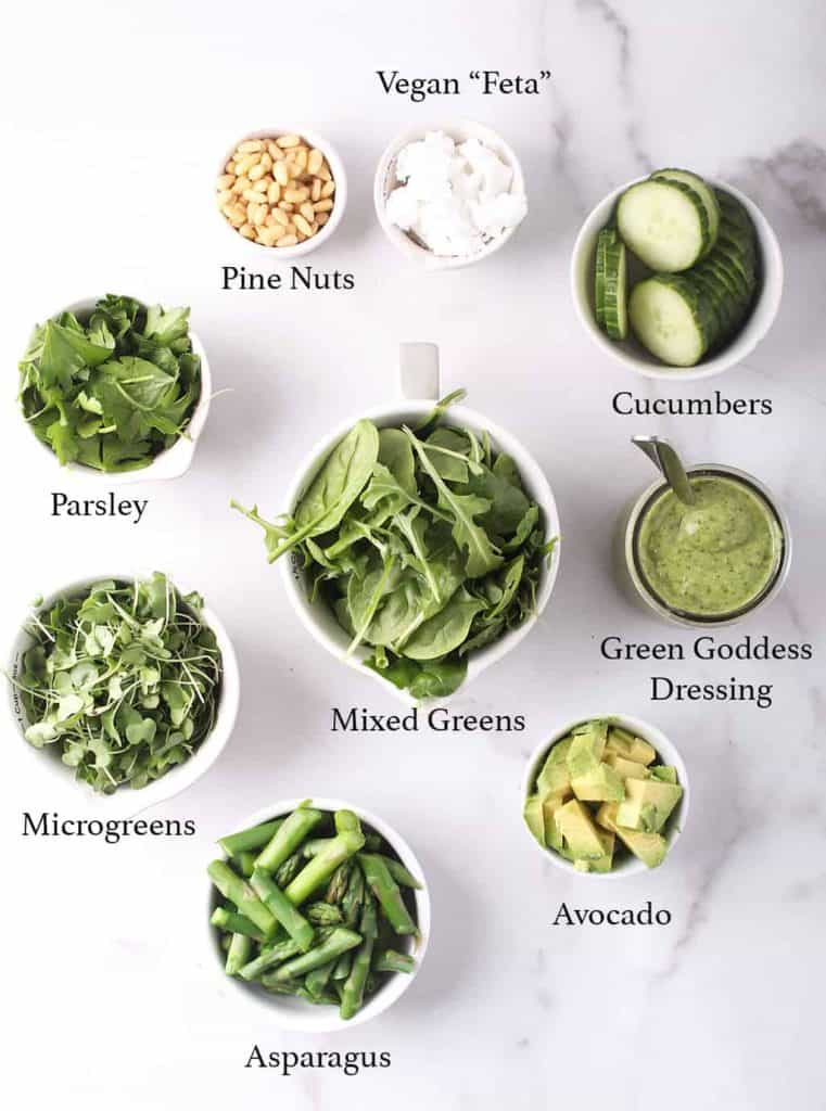 Ingredients for Green Goddess dressing on a marble countertop