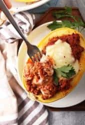 Finished stuffed spaghetti squash with a fork