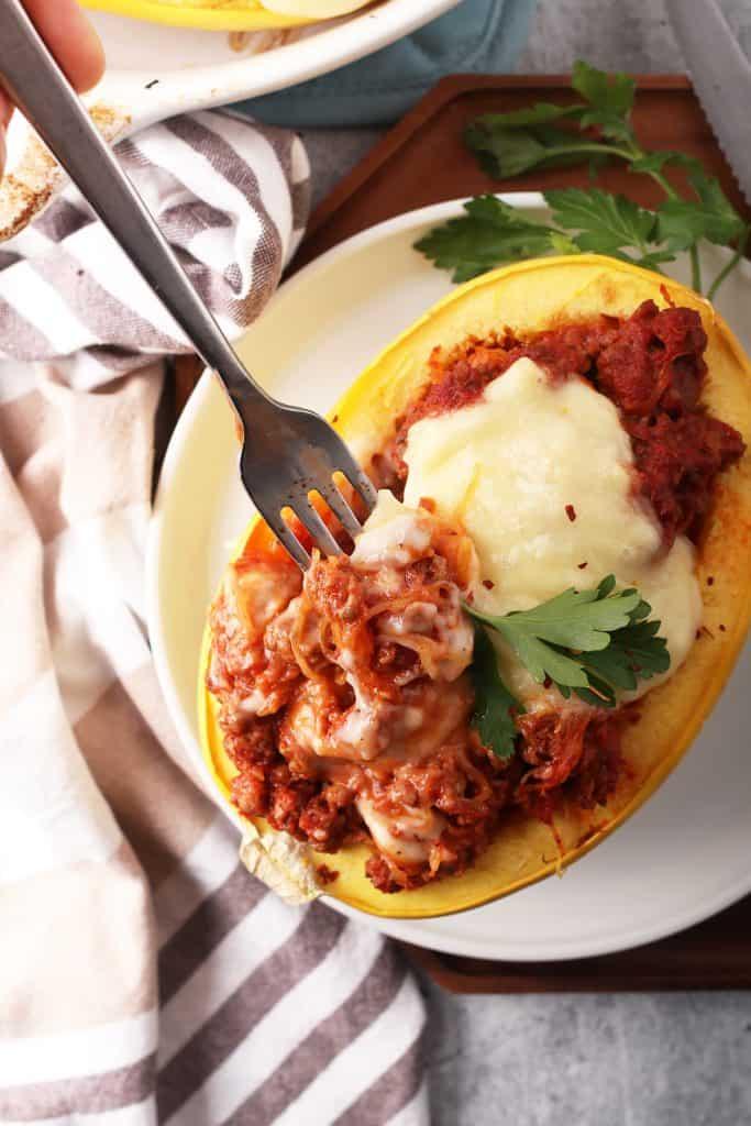 Finished stuffed spaghetti squash with a fork