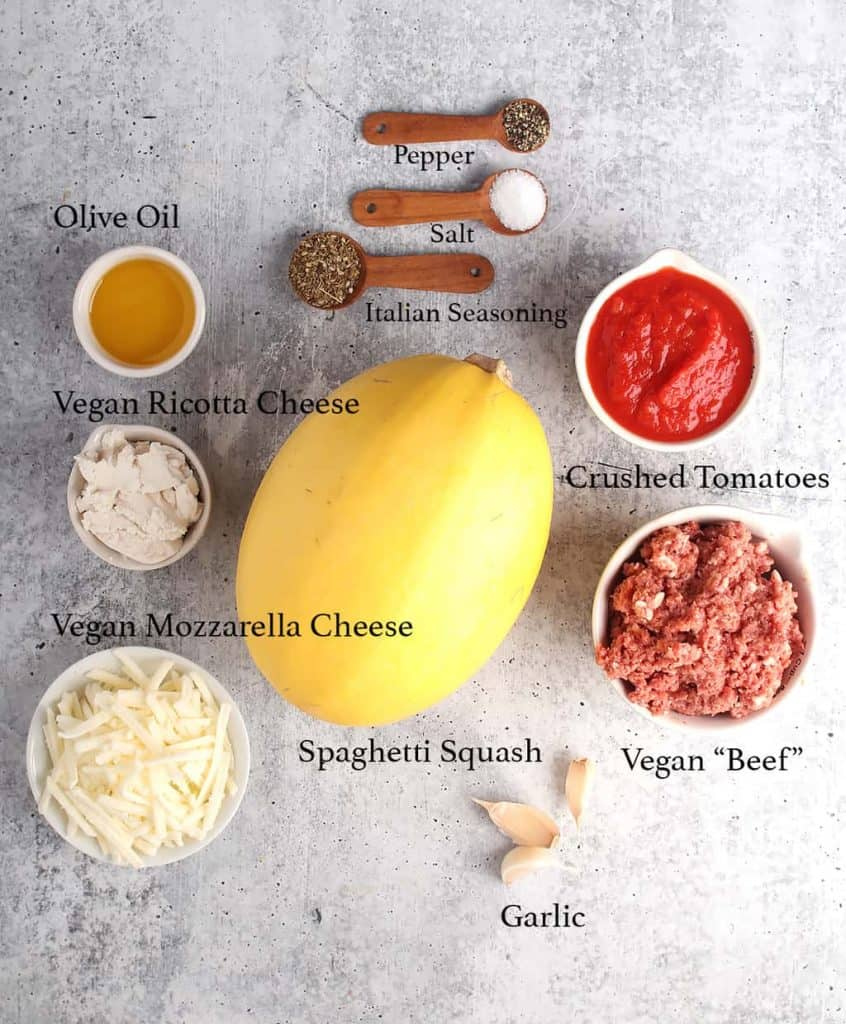 Ingredients for stuffed spaghetti squash on a concrete countertop