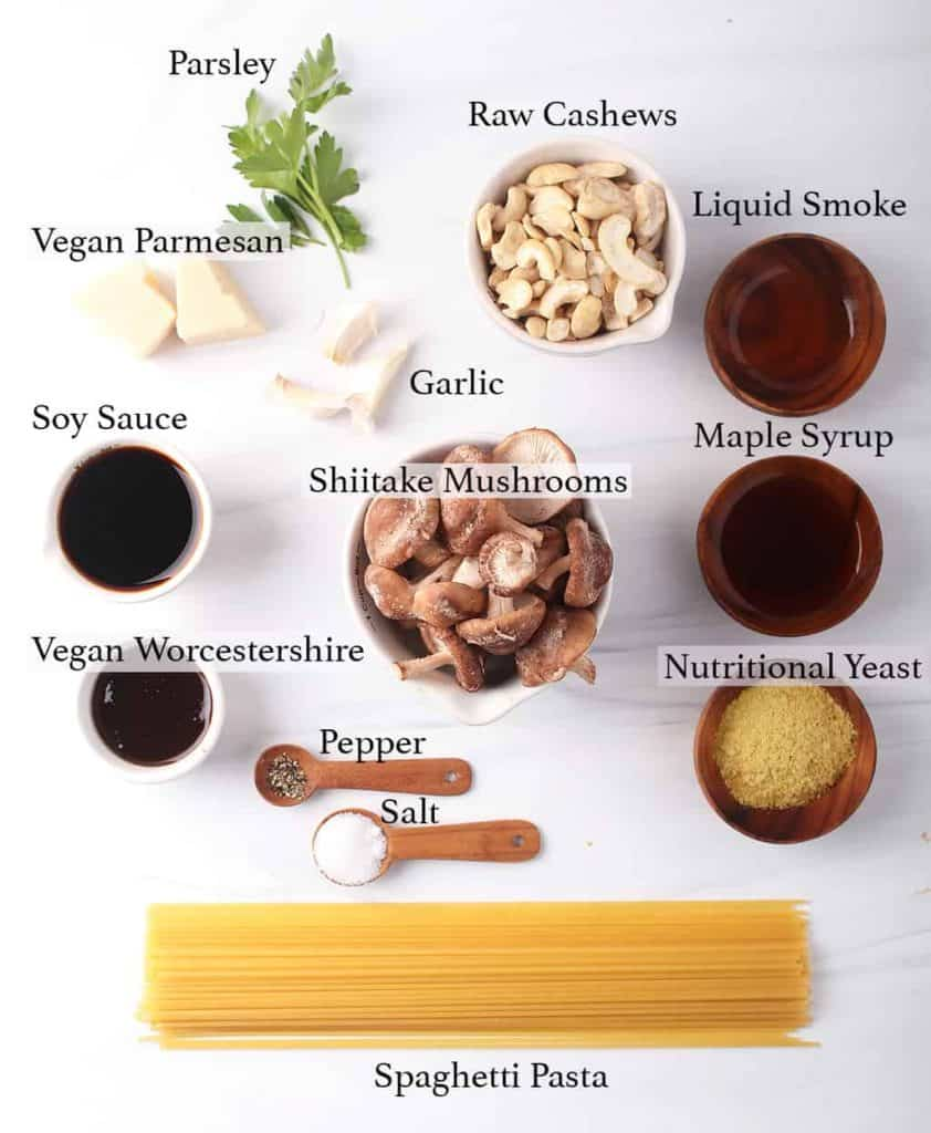 mise en place for vegan pasta carbonara recipe - spaghetti, mushrooms, nutritional yeast, liquid smoke, maple syrup, soy sauce, worchestershire, raw cashews, garlic, vegan parmesan, parsley