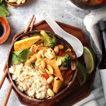 Bowl of red Thai curry served over rice.