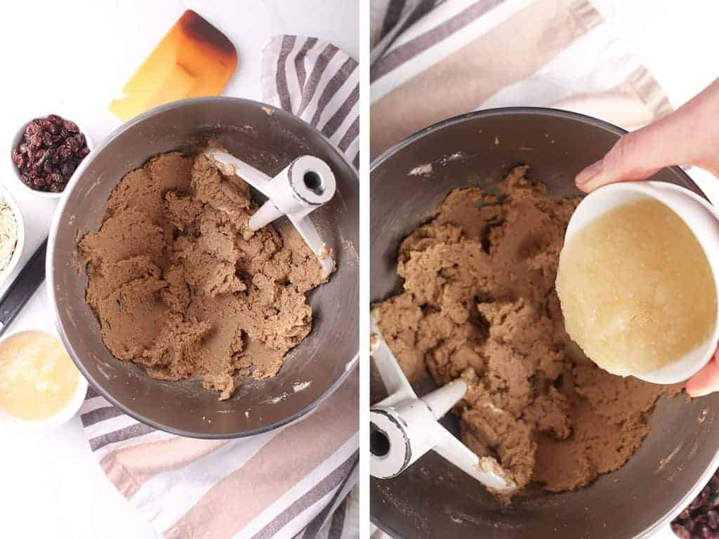 Cookie dough in a metal mixing bowl with the paddle attachment
