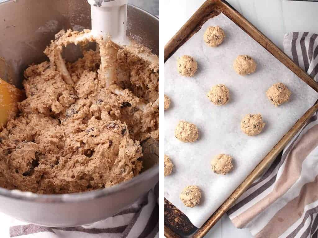 Oatmeal Raisin cookie dough rolled out into balls and placed on a baking sheet.