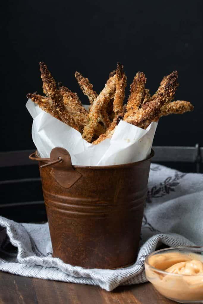 Basket of breaded asparagus fries