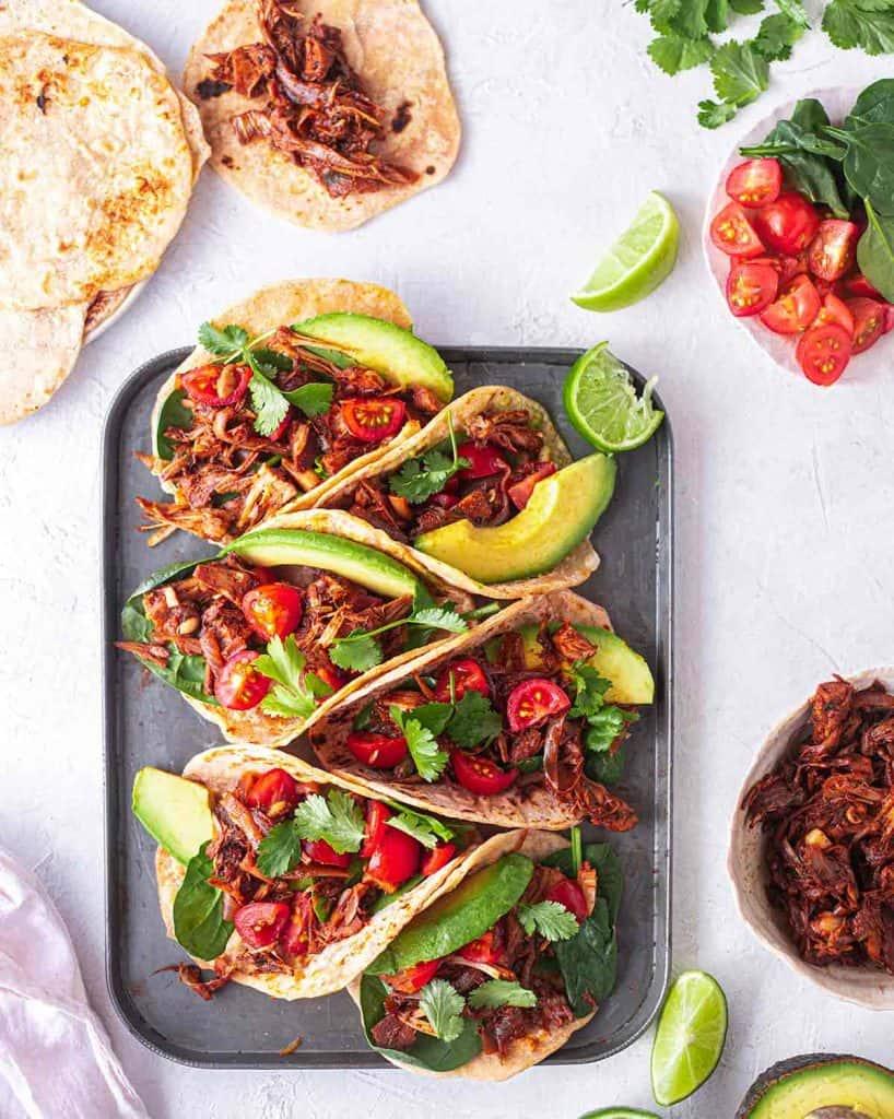 BBQ Jackfruit Tacos on a metal baking sheet