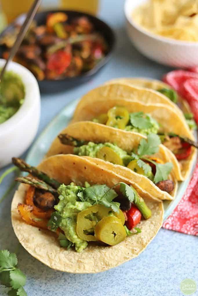 Asparagus and mushroom fajitas in corn tortillas