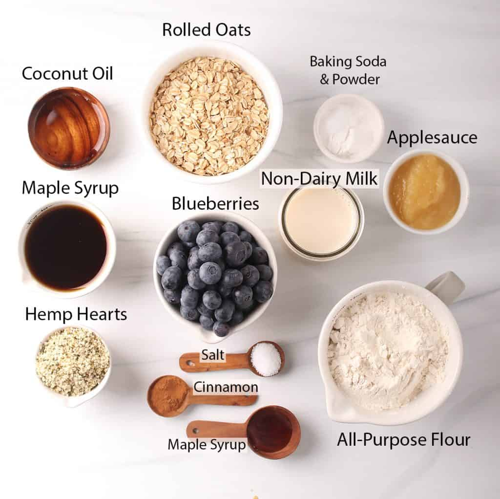 ingredients for healthy blueberry muffin recipe laid out on a white table