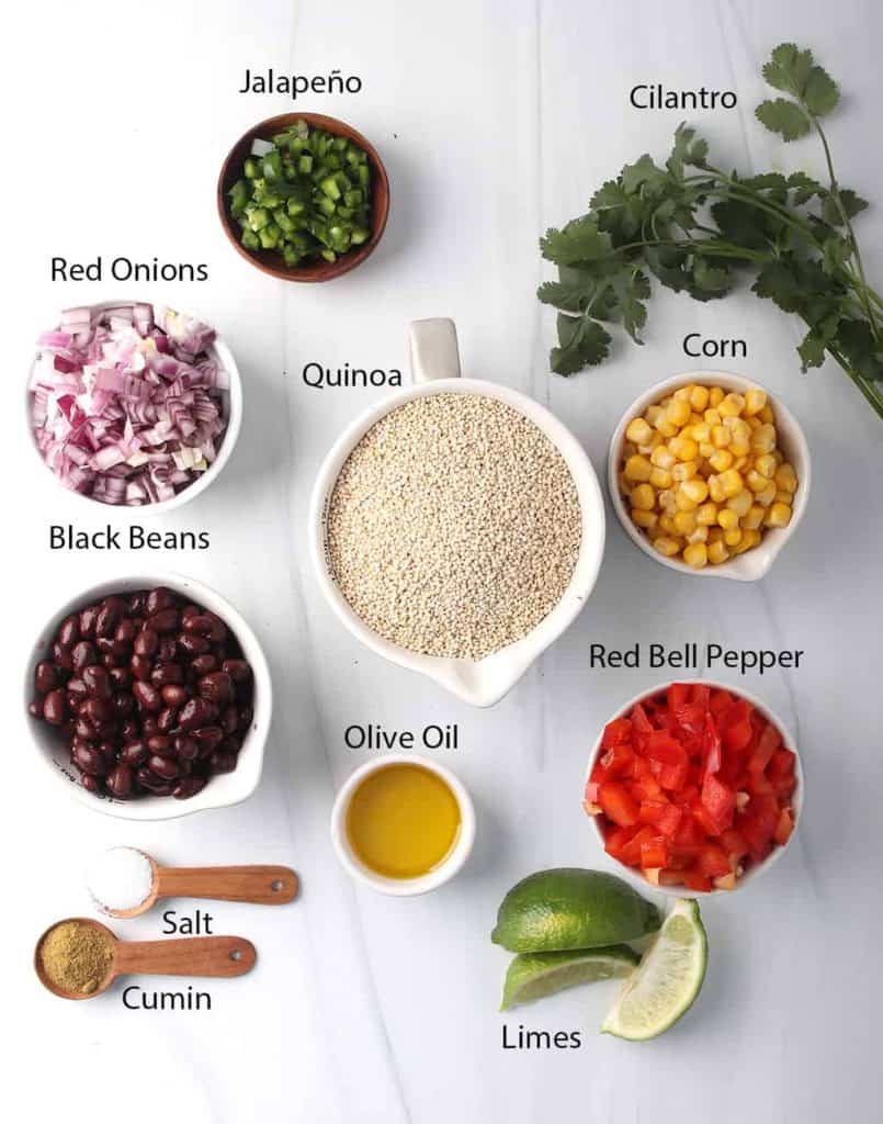 ingredients for southwest quinoa salad recipe laid out on white tabletop