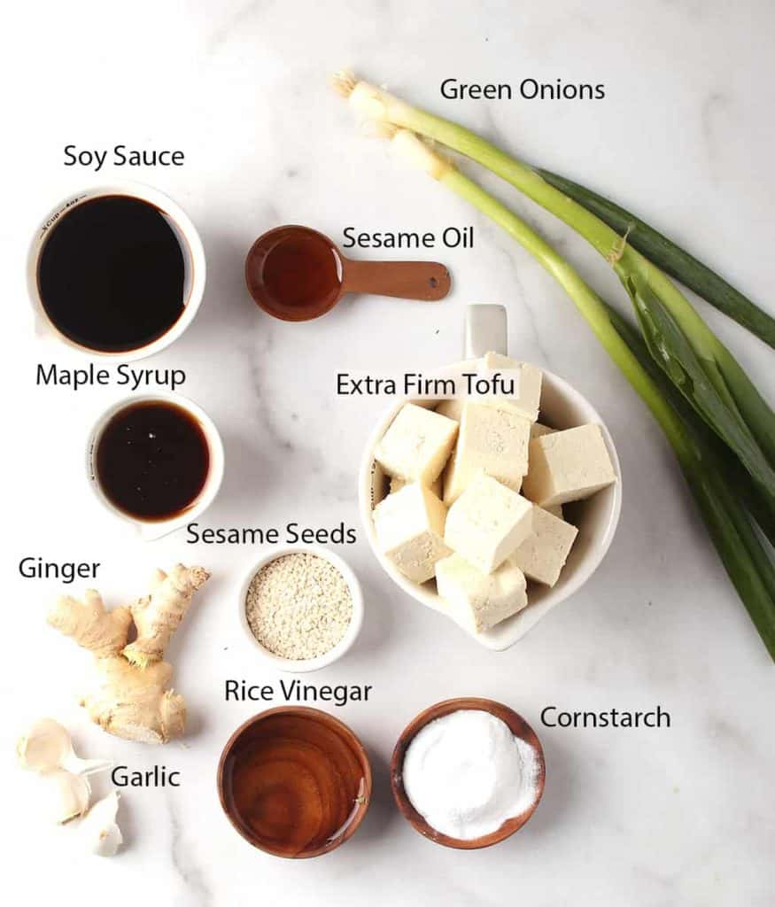 ingredients for vegan teriyaki tofu recipe laid out on a white tabletop