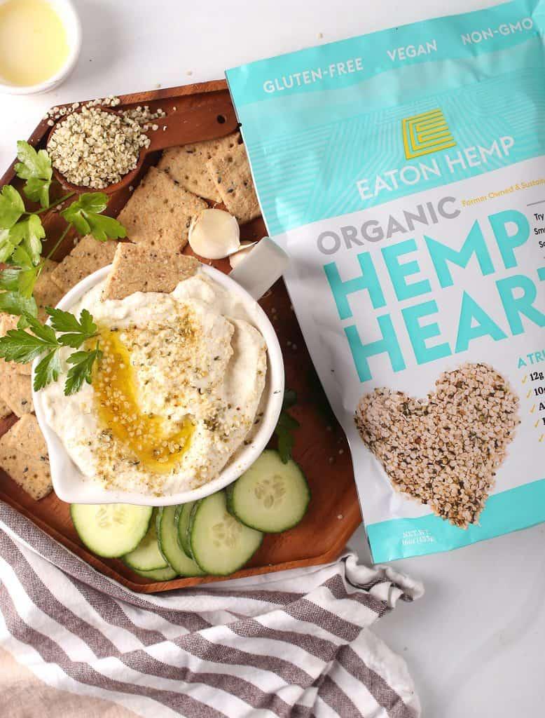 hemp cauliflower hummus (keto) served with olive oil, crackers, Eaton hemp, parsley, garlic and cucumbers