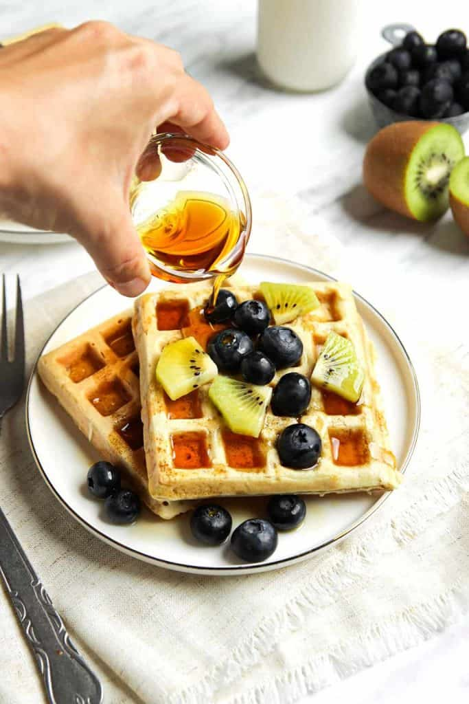 classic vegan waffles served with blueberries, kiwi and maple syrup