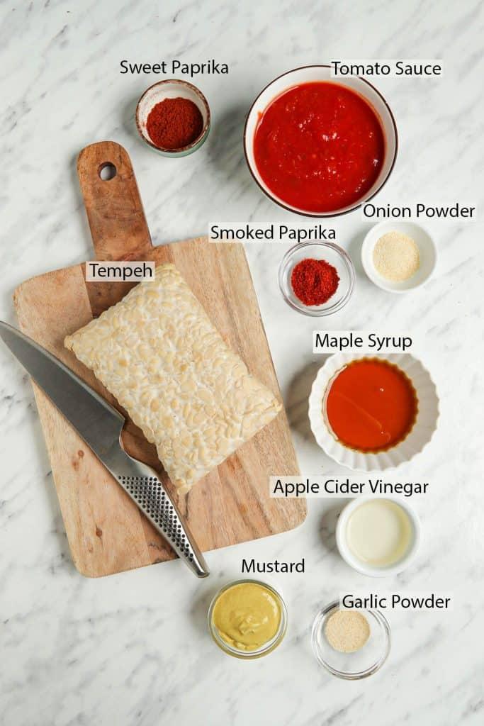 vegan ribs with tempeh recipe ingredients: tempeh, smoked paprika powder, maple syrup, apple cider vinegar, tomato sauce, vinegar, mustard, garlic powder and sweet paprika