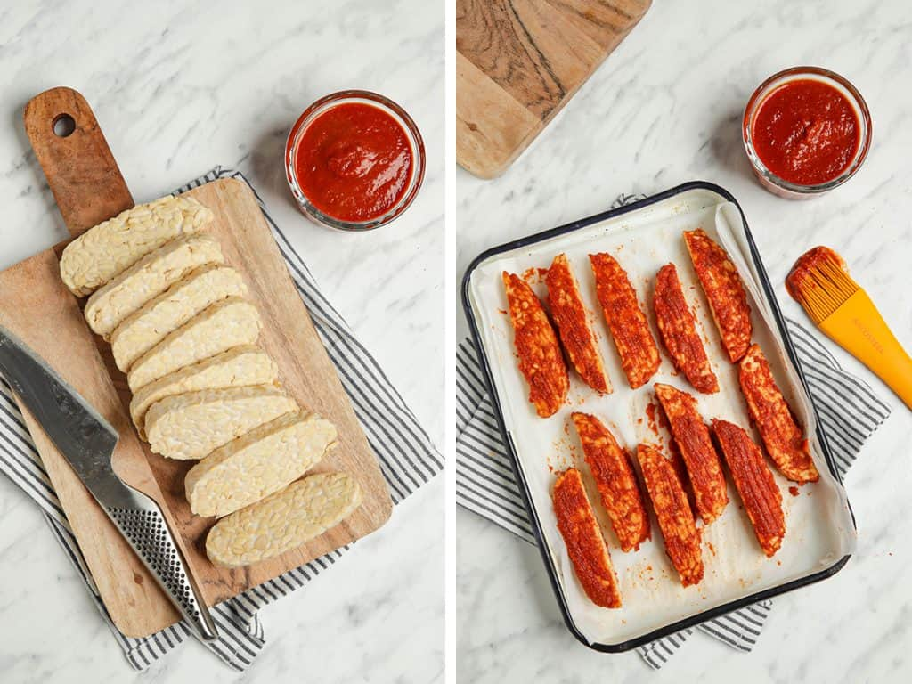 Chopped tempeh basted generously with sauce on one side in a baking tray.