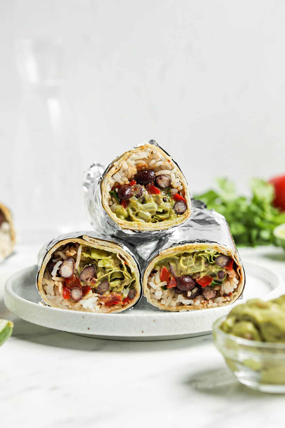 three burritos on white plate