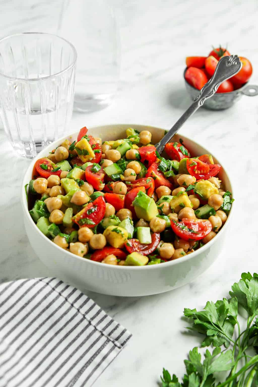 side view of chickpea salad with spoon in bowl