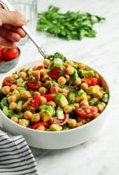 Spoonful of chickpea salad over white bowl