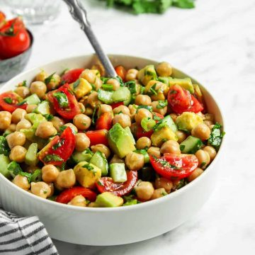 Front view of chickpea salad in white bowl