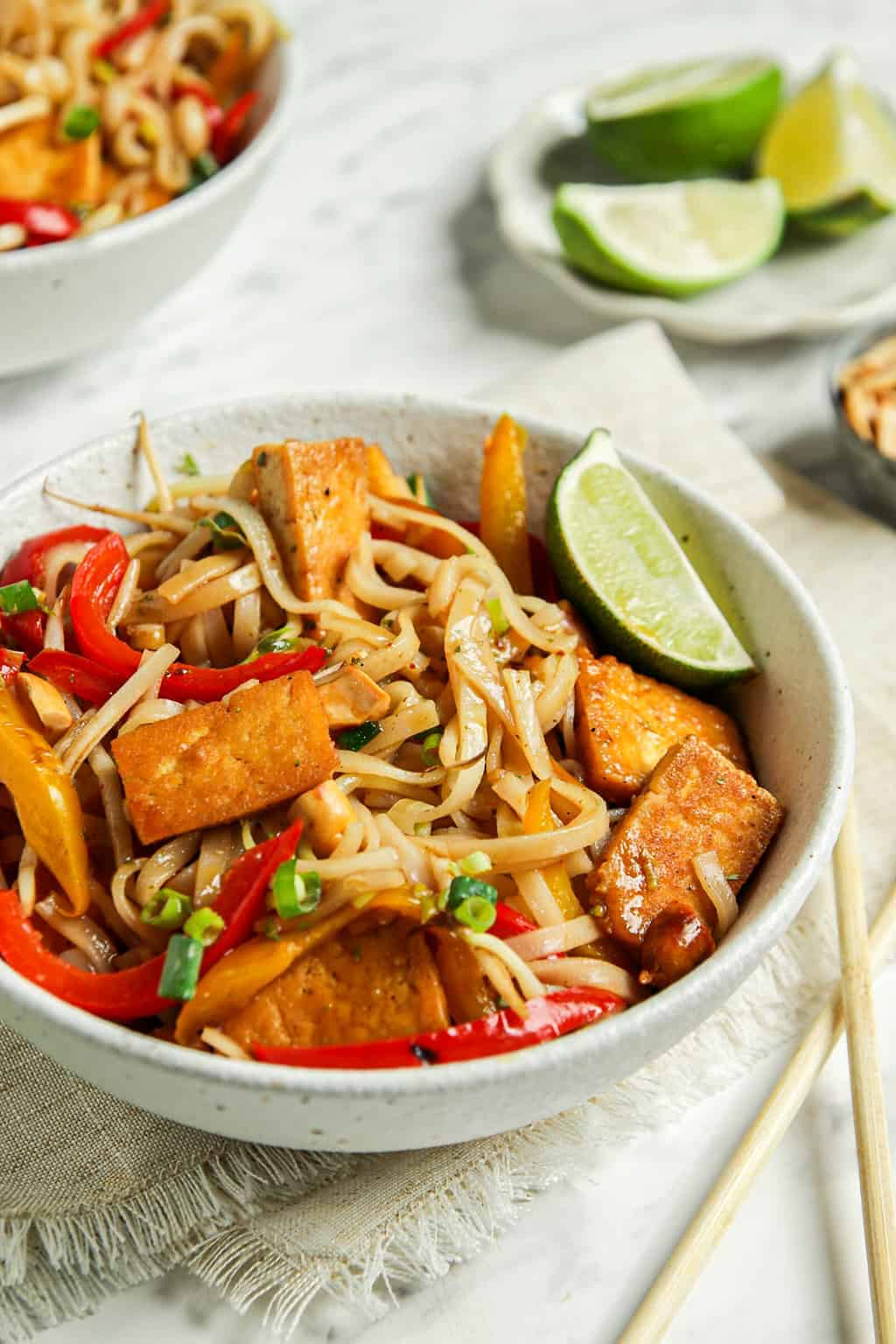 one bowl of vegan pad Thai with lime and tofu