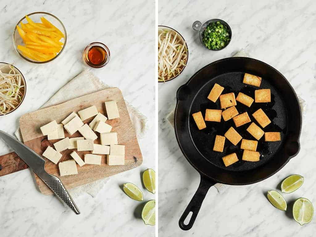 cubed tofu on cutting board transferred to cast iron skillet