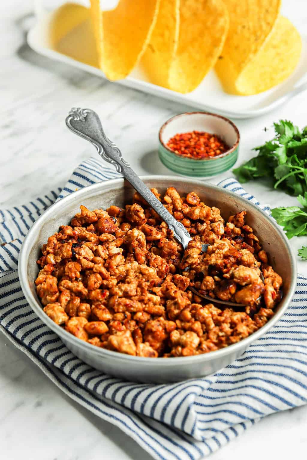vegan taco meat in bowl with spoon