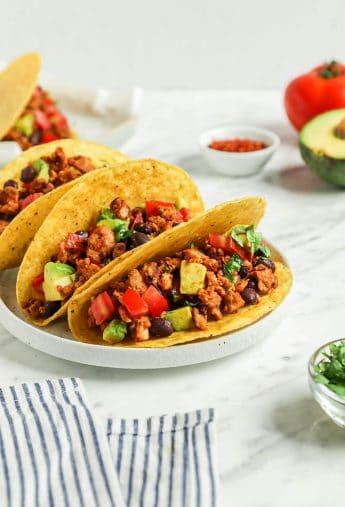 three tacos on plate