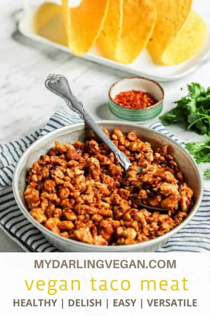 one bowl of vegan taco meat with tortillas in background