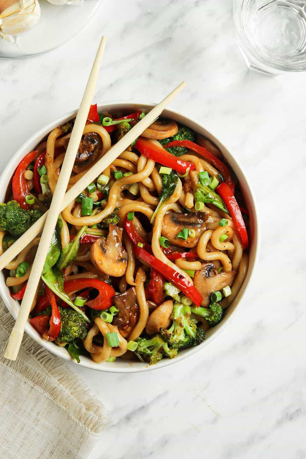 vegan yaki udon in bowl with chopsticks