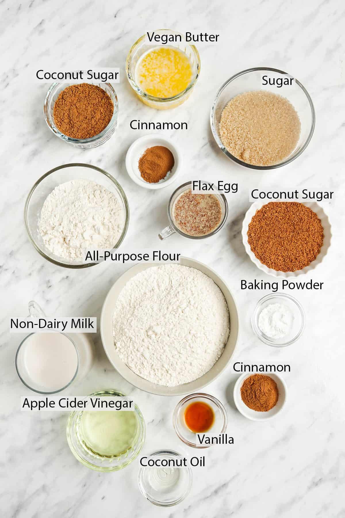 coconut sugar, cinnamon, sugar, flax egg, flour, baking powder, non dairy milk, apple cider vinegar, vanilla, and coconut oil