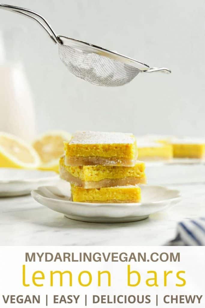 three lemon bars with powdered sugar