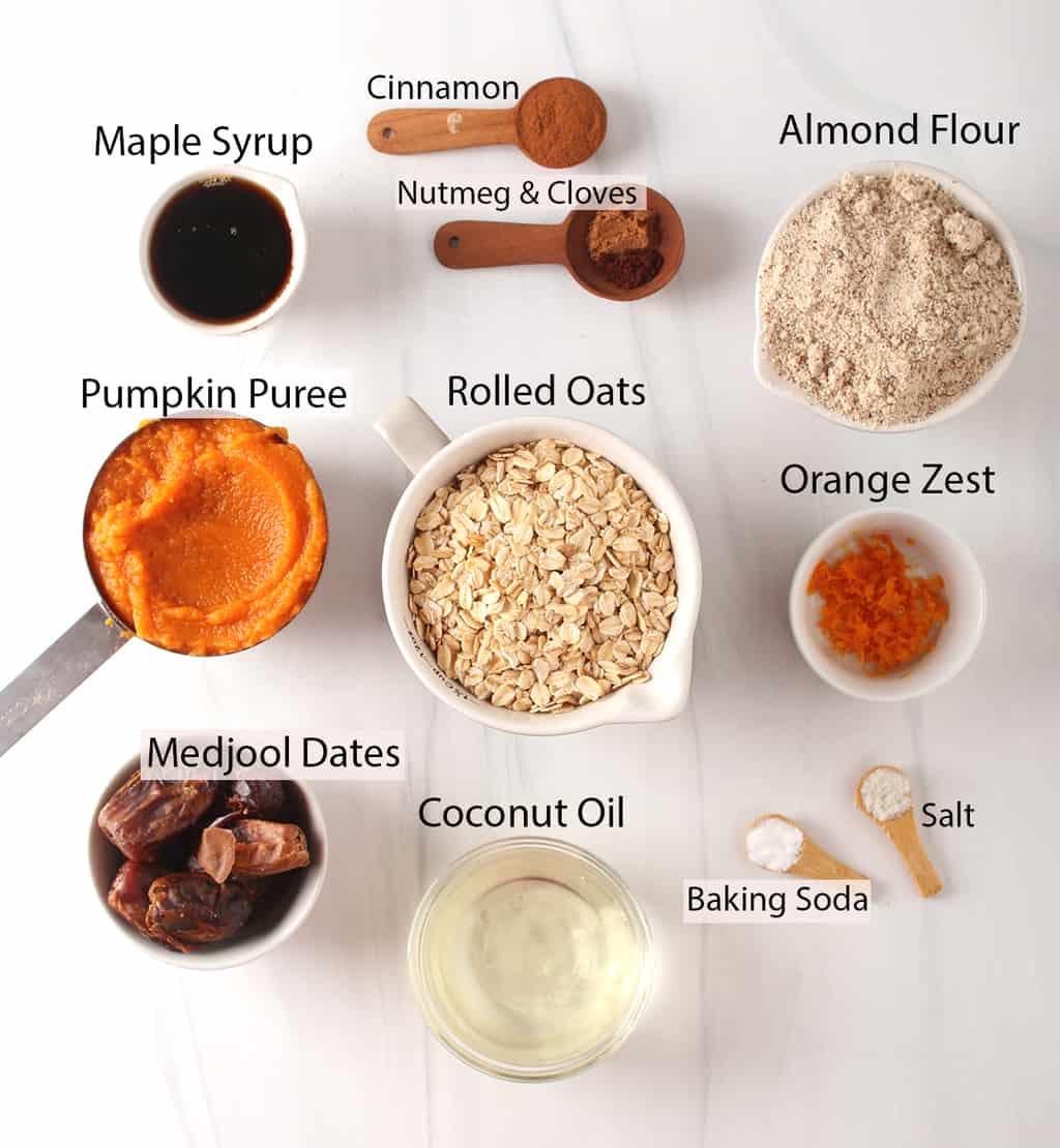 cinnamon, nutmeg, cloves, almond flour, maple syrup, pumpkin oats, orange, dates, oil, baking soda, salt
