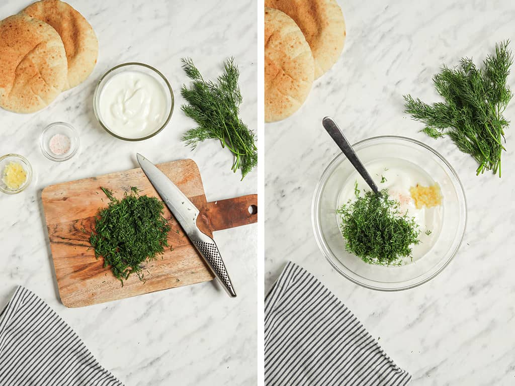 chopped resh dill on cutting board with knife then added to bowl with yogurt and garlic
