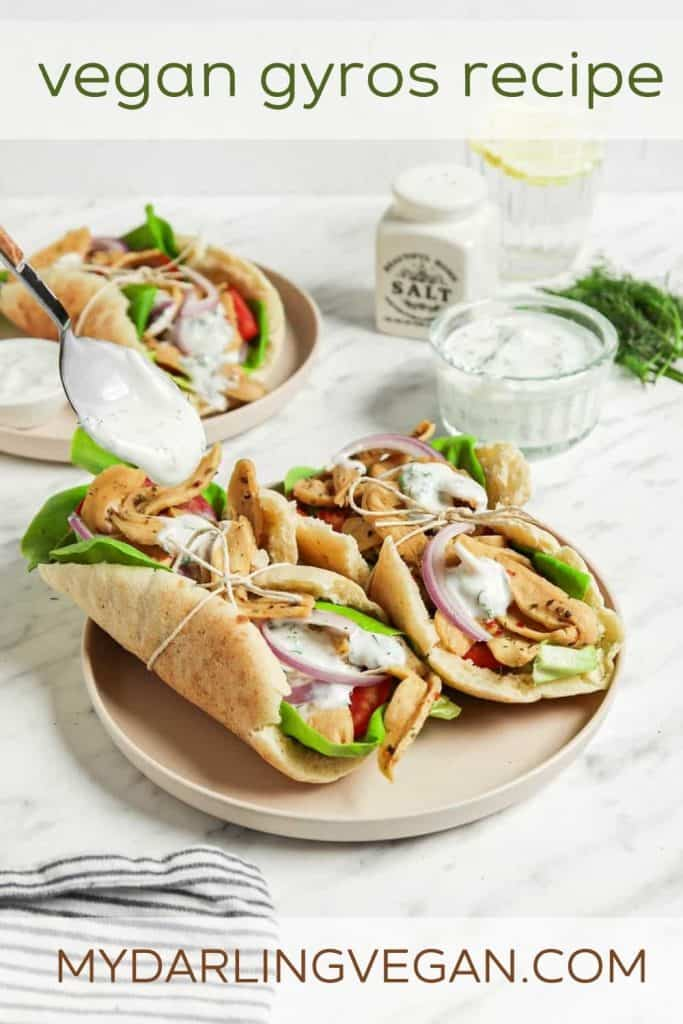 spoon drizzling tzatziki sauce over vegan gyros for Pinterest graphic