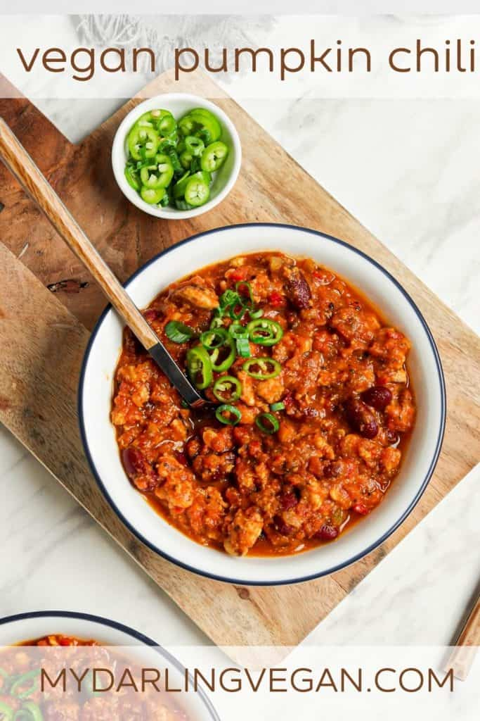 one bowl of vegan pumpkin chili in white bowl with Pinterest text