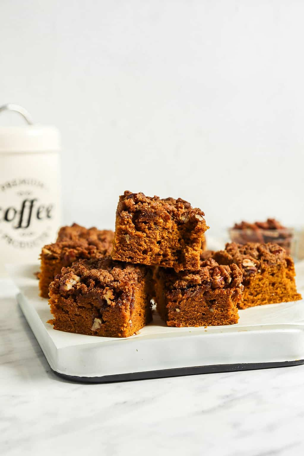 front view of stacked pumpkin coffee cake on white platter