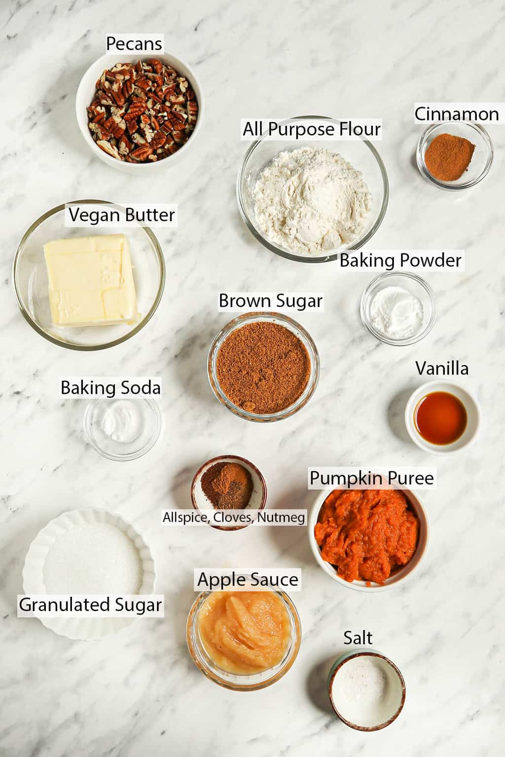 Ingredients for coffee cake measured out and placed on a marble countertop