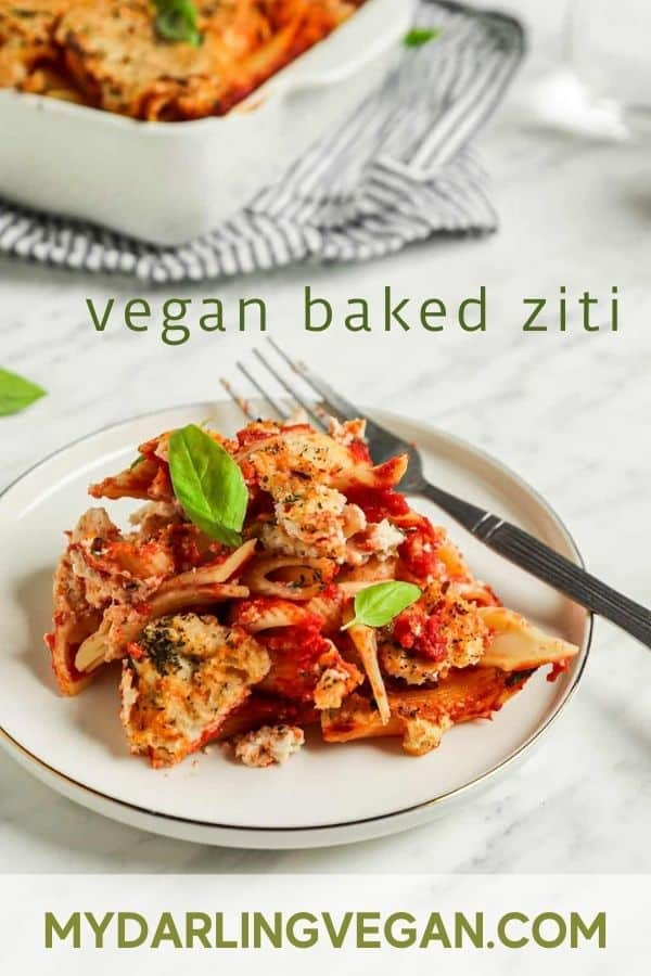 """baked ziti recipe on white plate with fork and basil with """"vegan baked ziti"""" text for Pinterest"""
