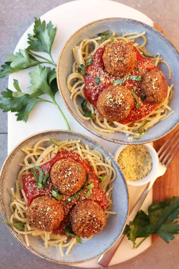 Vegan Meatballs with Tempeh Served over spaghetti and pasta sauce.