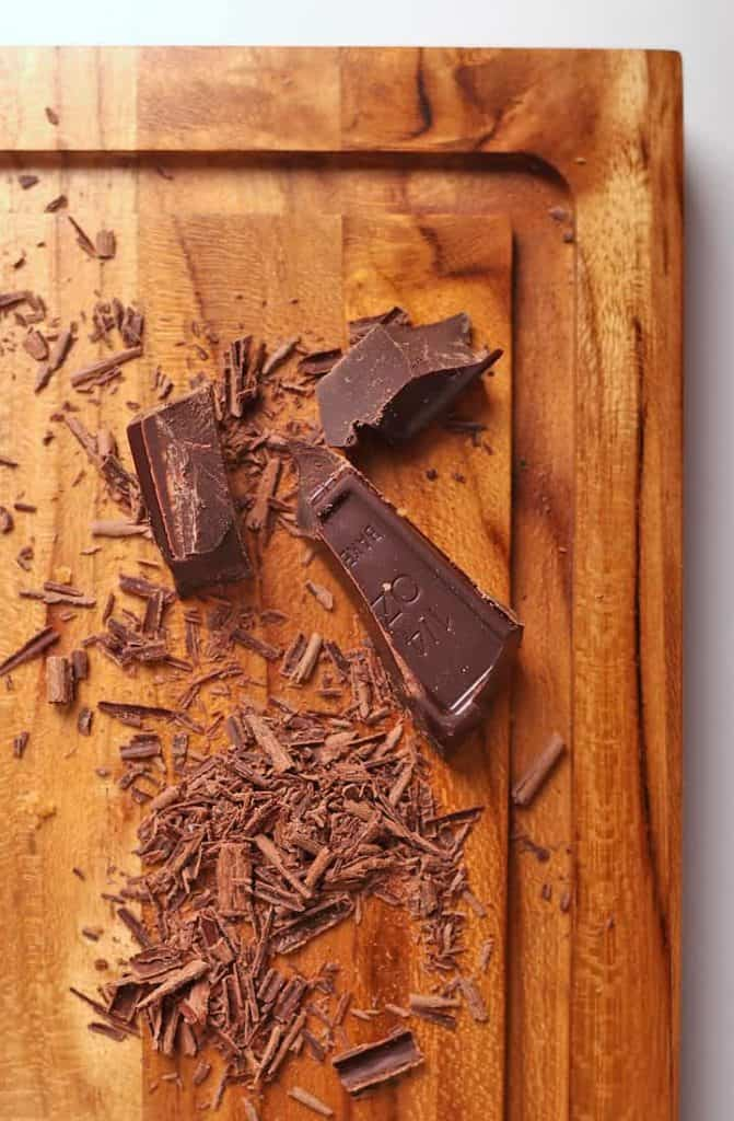 Dark chocolate shavings on a cutting board